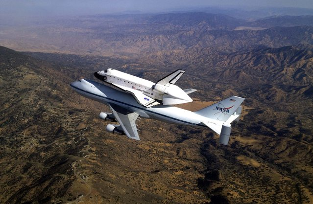 Space shuttle Endeavour, atop NASA's modified 747 carrier soars over the Tehachapi Mountains southeast of Bakersfield, California. (Photo by Jim Ross/NASA)