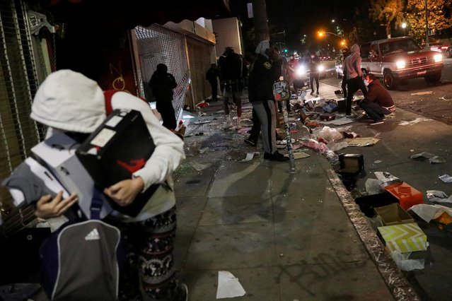 People loot property during nationwide unrest following the death in Minneapolis police custody of George Floyd, in Los Angeles, California, U.S., May 30, 2020. (Photo by Patrick T. Fallon/Reuters)