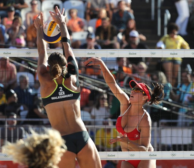 Isabelle Forrer of Switzerland (R) in action against Kira Walkenhorst of Germany (L) during the women's Beach Volleyball game of the Rio 2016 Olympic Games at the Beach Volleyball Arena on Copacabana Beach in Rio de Janeiro, Brazil, 13 August 2016. (Photo by Mario Ruiz/EPA)