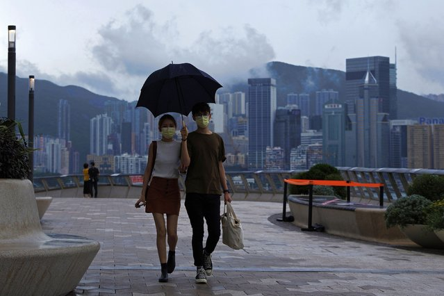 A couple walk along the waterfront of the Victoria Harbor of Hong Kong Tuesday, May 26, 2020. Hong Kong has been living on borrowed time ever since the British made it a colony nearly 180 years ago, and all the more so after Beijing took control in 1997, granting it autonomous status. A national security law approved by China's legislature Thursday is a reminder that the city's special status is in the hands of Communist Party leaders who have spent decades building their own trade and financial centers to take Hong Kong's place. (Photo by Kin Cheung/AP Photo)