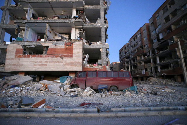 In this photo provided by the Iranian Students News Agency, ISNA, destroyed buildings and a car are seen after an earthquake at the city of Sarpol-e-Zahab in western Iran, Monday, November 13, 2017. (Photo by Pouria Pakizeh/ISNA via AP Photo)