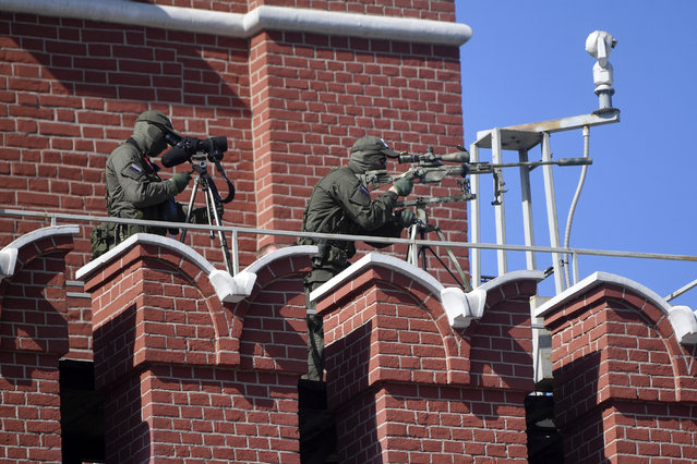Russian snipers secure the area prior to a military parade, which marks the 75th anniversary of the Soviet victory over Nazi Germany in World War Two, at Red Square in Moscow on June 24, 2020. The parade, usually held on May 9, was postponed this year because of the coronavirus pandemic. (Photo by Alexander Nemenov/AFP Photo)