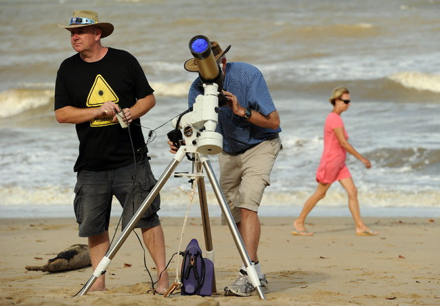 Equipment is made ready to be used for a direct feed of the total solar eclipse to NASA on the foreshore at Palm Cove in Tropical North Queensland on November 13, 2012. Tens of thousands of people were flocking to Australia's laid-back tropical north for a total solar eclipse on November 14, a phenomenon officials say has not been seen in the region in 1,300 years. (Photo by Greg Wood/AFP Photo)
