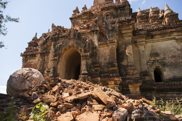 The damaged ancient Myauk Guni Temple is pictured, after a 6.8 magnitude earthquake hit Bagan, on August 25, 2016. A powerful 6.8 magnitude earthquake struck central Myanmar on August 24, killing at least three person and damaging pagodas in the ancient city of Bagan, officials said. The quake, which the US Geological Survey said hit at a depth of 84 kilometres (52 miles), was also felt across neighbouring Thailand, India and Bangladesh, sending panicked residents rushing onto the streets. (Photo by Ye Aung Thu/AFP Photo)