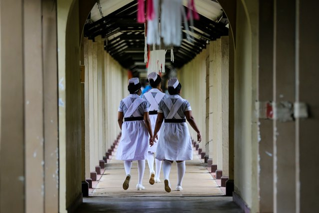 Group of Sri Lankan nurses leave after the International Nurses Day celebration at the Infectious Diseases Hospital (IDH) in Colombo, Sri Lanka,12 May 2020. The infectious disease hospital (IDH) is the main hospital in Sri Lanka to treat patients who are positive for coronavirus. International Nurses Day is marked annually to commemorate the birth anniversary of British nurse Florence Nightingale on 12 May 1820, who was the founder of modern nursing. (Photo by Chamila Karunarathne/EPA/EFE)
