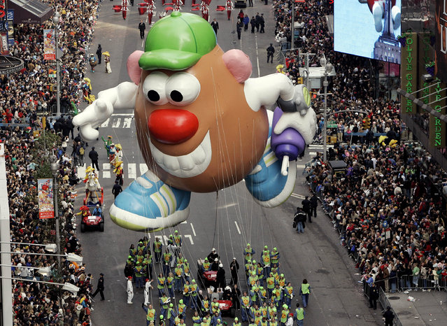The Mr. Potato Head  balloon floats down Broadway during the Macy's Thanksgiving Day parade in New York, Thursday, November 22, 2007. (Photo by Jeff Christensen/AP Photo)