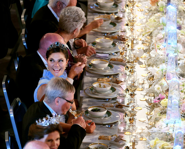 Crown Princess Victoria of Sweden is seen at the table of honour during the Nobel Banquet at the City Hal in Stockholm, Sweden December 10, 2017. (Photo by Fredrik Sandberg/Reuters/TT News Agency)