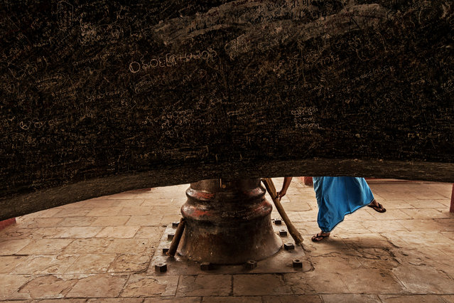 """Mingun bell"". A buddhist man is gonna play the Mingun bell, the biggest suspended and working bell in the world. Photo location: Mingun, Myanmar. (Photo and caption by Michele Martinelli/National Geographic Photo Contest)"
