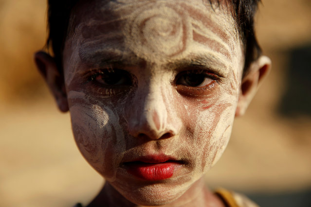 A Rohingya refugee girl has her face painted at the Balukhali refugee camp near Cox's Bazar, Bangladesh December 17, 2017. (Photo by Alkis Konstantinidis/Reuters)
