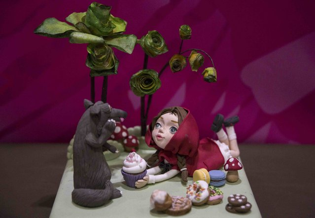"A cake decorated as a scene from the children's story ""Little Red Riding Hood"" is displayed at the Cake and Bake show in London, Britain October 3, 2015. (Photo by Neil Hall/Reuters)"