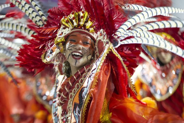 Members of the samba school Academicos do Tatuape participate in a carnival parade at the sambodromo of Anhembi in Sao Paulo, Brazil, 08 February 2013. The carnival started paying hommage to singer Beth Carvalho, one of the most important Samba voices, that inspired the parade of Academicos do Tatuape. (Photo by Sebastiao Moreira/EPA)