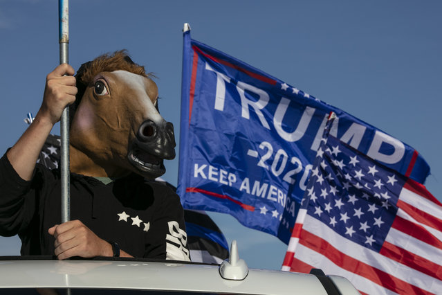 Supporters of President Donald Trump attend a rally and car parade Saturday, August 29, 2020, from Clackamas to Portland, Ore. (Photo by Paula Bronstein/AP Photo)