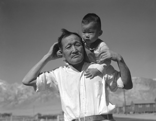 """Manzanar Relocation Center, Manzanar, California, July 2, 1942. Grandfather and grandson of Japanese ancestry at the War Relocation Authority center"". (Photo by Dorothea Lange)"