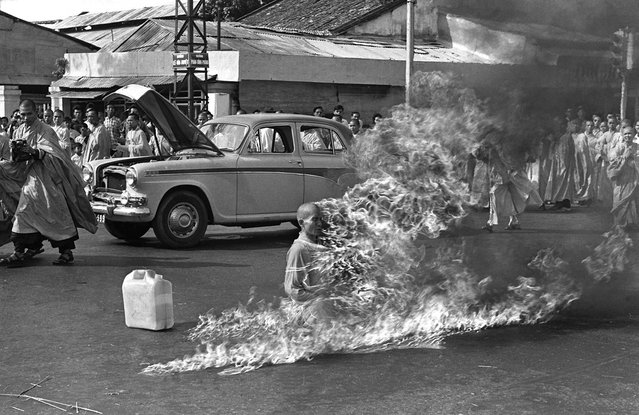 Thich Quang Duc, a Buddhist monk, burns himself to death on a Saigon street to protest alleged persecution of Buddhists by the South Vietnamese government, on June 11, 1963. (Photo by Malcolm Browne/AP Photo)