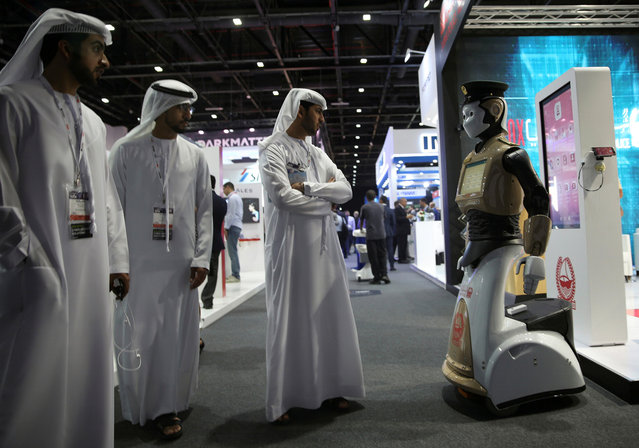 Visitors look at an operational robot policeman at the opening of the 4th Gulf Information Security Expo and Conference (GISEC) in Dubai, United Arab Emirates, May 22, 2017. (Photo by Reuters/Stringer)