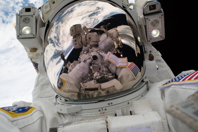 "Spacewalker Mark Vande Hei took his own photograph during the first spacewalk of 2018,  on January 23, 2018. These sky-high pictures are better known as ""space-selfies"". (Photo by Mark Vande Hei/NASA)"