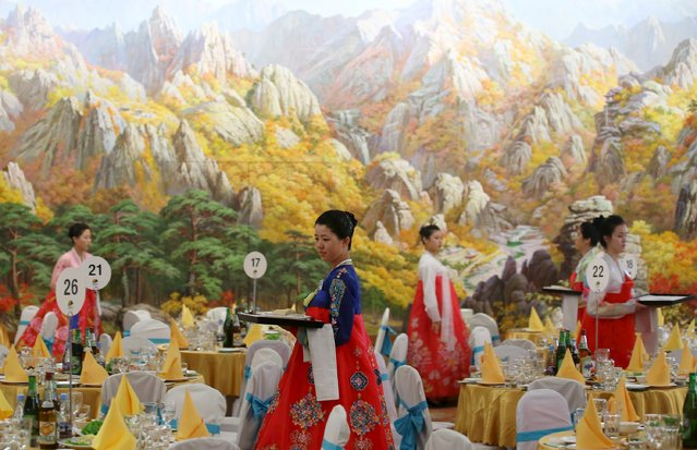 North Korean women prepare for a group luncheon during the separated family reunions  at Mount Kumgang resort, North Korea, October 21, 2015. (Photo by Reuters/Yonhap)