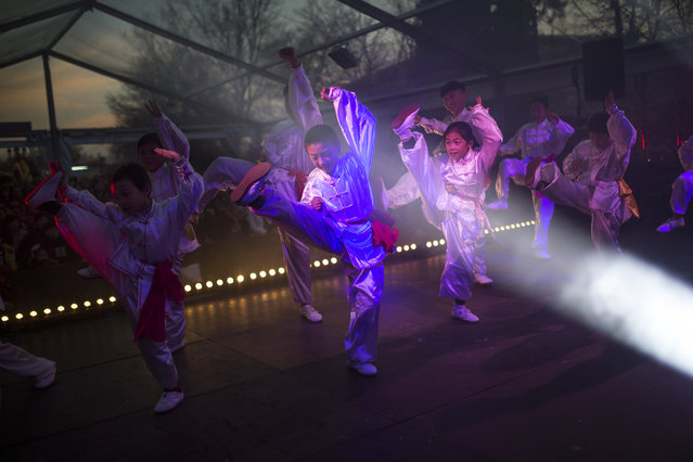 Martial arts young students performance on the stage during celebrations on the first day of the Chinese Lunar New Year in Madrid, Friday, February 16, 2018. Chinese around the world celebrated the arrival of the Year of the Dog on Friday with family reunions, firecrackers and traditional food. (Photo by Francisco Seco/AP Photo)