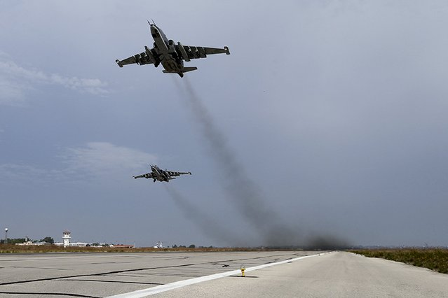 Sukhoi Su-25 fighter jets take off from the Hmeymim air base near Latakia, Syria, in this handout photograph released by Russia's Defence Ministry October 22, 2015. (Photo by Reuters/Ministry of Defence of the Russian Federation)