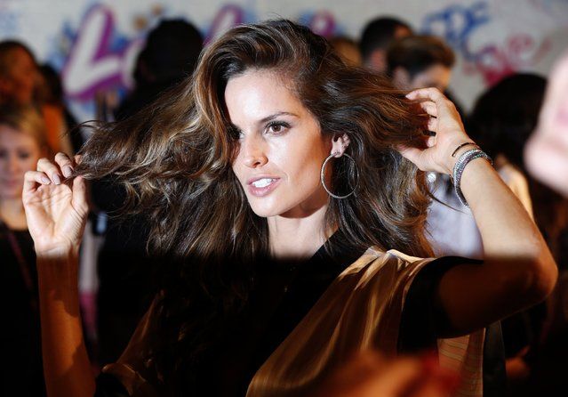 Model Alessandra Ambrosio prepares ahead of the 2014 Victoria's Secret Fashion Show in London December 2, 2014. (Photo by Suzanne Plunkett/Reuters)