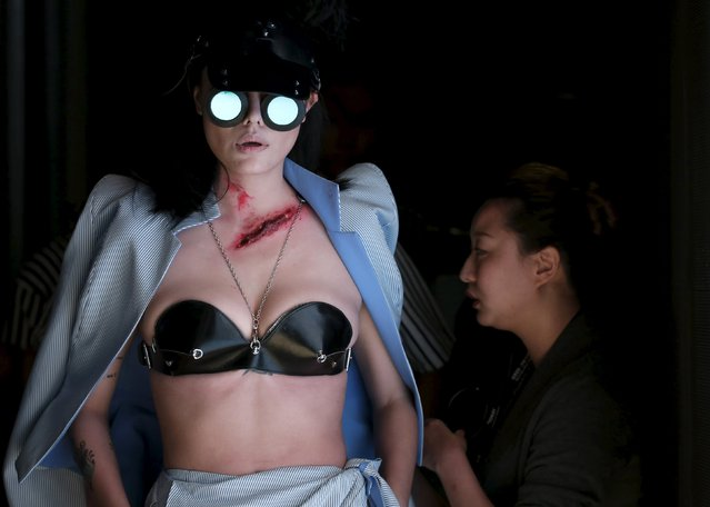 A model waits to present a creation by Chinese designer Hu Sheguang for his collection show during China Fashion Week S/S 2016 in Beijing October 26, 2015. (Photo by Jason Lee/Reuters)