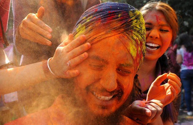 Students playing with colours ahead of Holi at Panjab University  on March 1, 2018 in Chandigarh, India. (Photo by Anil Dayal/Hindustan Times via Getty Images)