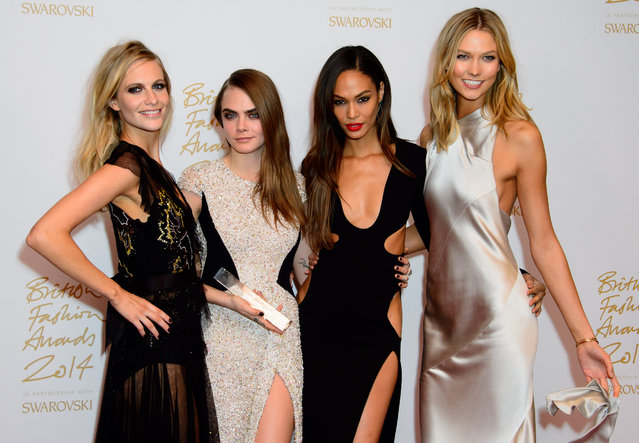Models Poppy Delevigne, Cara Delevigne, Joan Smalls and Karlie Kloss pose for photographers with her Model of the year award at The British Fashion Awards 2014, in London, Monday, December 1, 2014. (Photo by Jonathan Short/Invision/AP Photo)