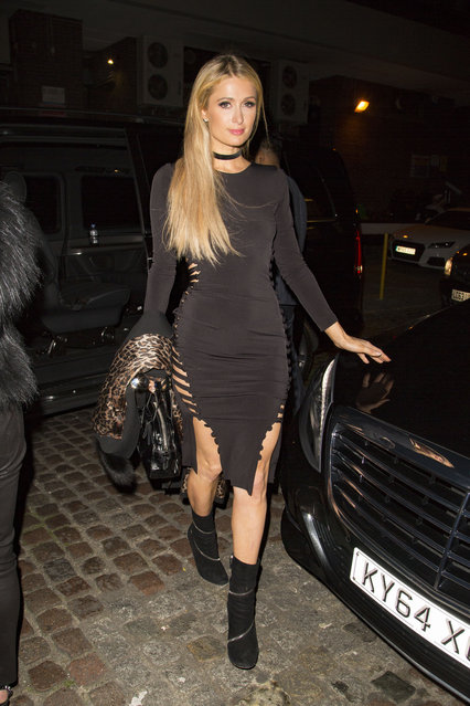 Paris Hilton and friends arriving at the Chiltern Firehouse in a black slit dress at midnight October 6, 2016. (Photo by Splash News and Pictures Los Angeles)