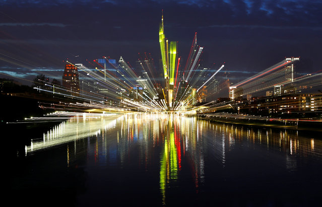 The skyline, with its characteristic banking towers, is reflected in river Main in Frankfurt, Germany, October 1, 2017. Zoomed image is taken on slow shutter speed. (Photo by Kai Pfaffenbach/Reuters)