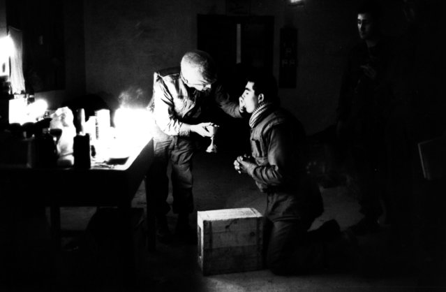 Marine chaplain Eli Tavesian giving communion to marine Louis A Loya, at Forward Command Post in Hue, Vietnam, 1968. (Photo by Terry Fincher/Daily Express/Hulton Archive/Getty Images)