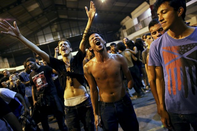 Heavy metal fans react while dancing during a fund raising concert for Syrian refugees in Brazil, in Rio de Janeiro November 8, 2015. (Photo by Nacho Doce/Reuters)