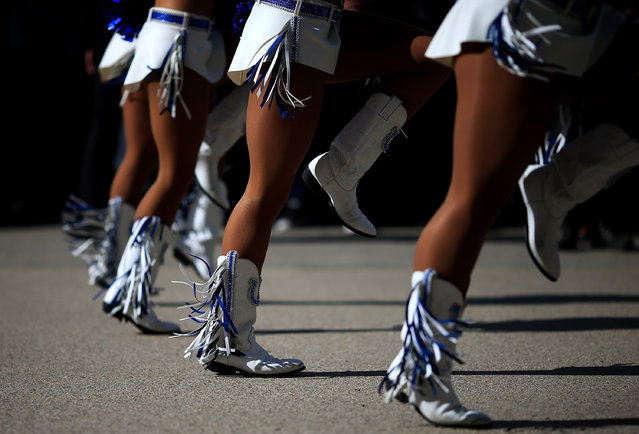 Indianapolis Colts cheerleaders perform outside the stadium ahead of the NFL International Series match between Indianapolis Colts and Jacksonville Jaguars at Wembley Stadium on October 2, 2016 in London, England. (Photo by Ben Hoskins/Getty Images)