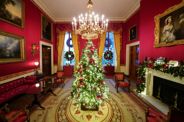 The Red Room of the White House is adorned with holiday decorations during a press preview in Washington, U.S., November 30, 2020. (Photo by Kevin Lamarque/Reuters)
