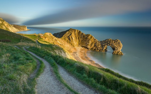 Undated handout issued by Take a view of the last of the evening light on Durdle Door, Jurassic Coast, Dorset, England which won the Youth Classic View category in this year's Landscape Photographer of the Year Awards.  (Photo by Jake Pike/PA Wire)