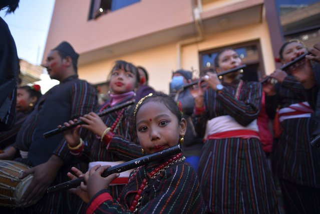 Nepalese girls playing traditional flute during the celebration of Mahalaxmi Festival at Thankot, Kathmandu, Nepal on Tuesday, December 01, 2020. Mahalaxmi Festival is the annual festival to honor of the goddess Mahalaxmi and Ganesh are carried to the Mahalaxmi temple. A vermillion power and red colored powder, is thrown on participants and chariots as festival is accompanied by traditional music and dance. (Photo by Narayan Maharjan/NurPhoto via Getty Images)