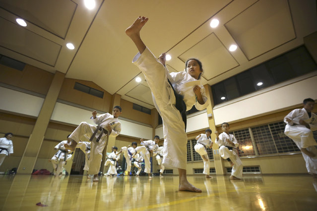 In this November 18, 2015 photo, 9-year-old Mahiro Takano, center, three-time Japan karate champion in her age group practices in Nagaoka, Niigata Prefecture, north of Tokyo. (Photo by Eugene Hoshiko/AP Photo)