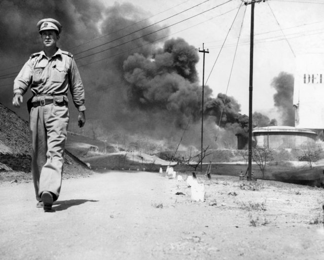 Japanese forces driving through Yenangyaung and Mandalay in Burma during April and May found little left of the cities except charred ruins and heaps of blackened debris. Before the fall of Yenangyaung, April 21, 1942, the skies were afire with the blazing skeletons of oil-field derricks. Steel structures were warped by bonfires lighted beneath them; machinery was destroyed and repair shops were razed. Destruction of the city was completed over a three week period of time. All that remained to be burned on the last day were houses kept intact until the last minute for the use of evacuees and troops. The $1,000,000 power plant running the Yenangyaung oil fields was blown to pieces. At Mandalay the story was the same. The pagoda-crowned city which fell to the Japanese on May 2, was deserted and in ruins-mostly caused by Japanese bombings, partly by the scorched earth policy of the evacuating British forces, partly by the work of fifth columnists and looters. (Photo by AP Photo)