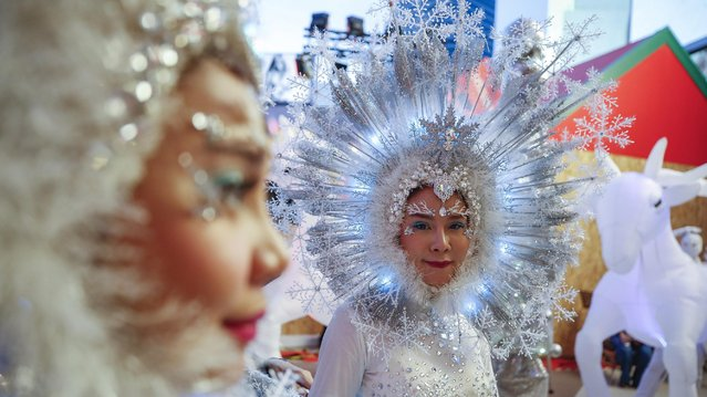 Performers prepare for a show at a Christmas fair outside a mall in Bangkok, Thailand, 20 December 2020. Malls and local stores use festive decorations hoping to attract customers and revive businesses hurt by the COVID-19 coronavirus pandemic. (Photo by Diego Azubel/EPA/EFE)