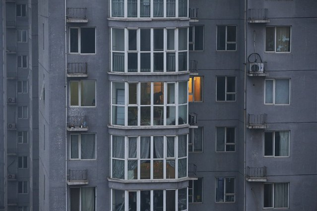 A man is seen inside his apartment in Yanjiao, Hebei province, China, November 13, 2015. (Photo by Jason Lee/Reuters)