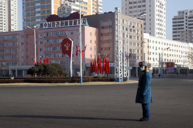 A traffic officer stand in attention along a main street of the Central District in Pyongyang, North Korea, on Wednesday, January 6, 2021. The Workers' Party Congress is one of the North's biggest propaganda spectacles and is meant to help leader Kim Jong Un show his people that he's firmly in control and boost unity in the face of COVID-19 and other growing economic challenges. (Photo by Jon Chol Jin/AP Photo)