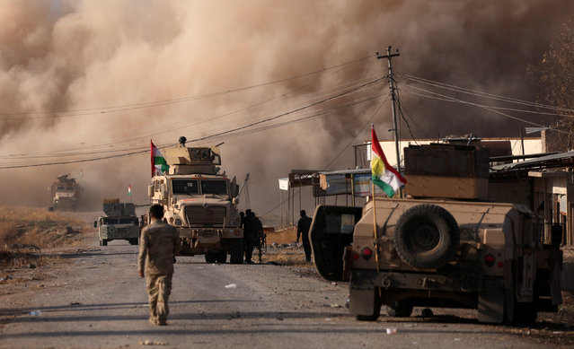Smoke rises during clashes between Peshmerga forces and Islamic State militants in the town of Bashiqa, east of Mosul, during an operation to attack Islamic State militants in Mosul, Iraq, November 7, 2016. (Photo by Azad Lashkari/Reuters)