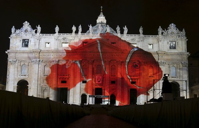 """A picture of clownfish, part of an art projection featuring images of humanity and climate change artistically rendered by Obscura Digital, is projected onto the facade of St. Peter's Basilica, as part of an installation entitled """"Fiat Lux: Illuminating our Common Home"""" as a gift to Pope Francis on the opening day of the Extraordinary Jubilee, at the Vatican, December 8, 2015. (Photo by Stefano Rellandini/Reuters)"""