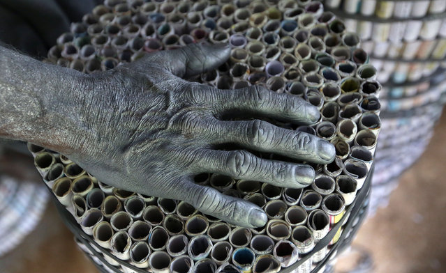 A worker's hand is covered with gunpowder at a fireworks factory in Kimbulapitiya, Sri Lanka on December 10, 2015. (Photo by Sanka Gayashan/Shutterstock/Rex Feature)
