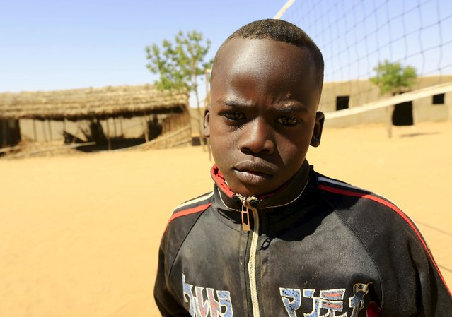 Yousif Abdu Al Rahman poses for a photograph in Aboshouk camp in Darfur, Sudan, November 17, 2015. Born in the camp, 12-year-old Yousif wishes to be an engineer or a journalist in his adulthood. (Photo by Mohamed Nureldin Abdallah/Reuters)