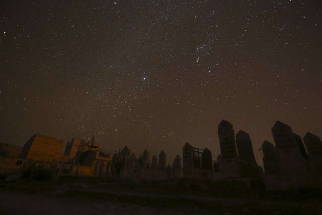 A graveyard is pictured at night in Aleppo, Syria December 11, 2015. Picture taken December 11, 2015. (Photo by Ammar Abdullah/Reuters)