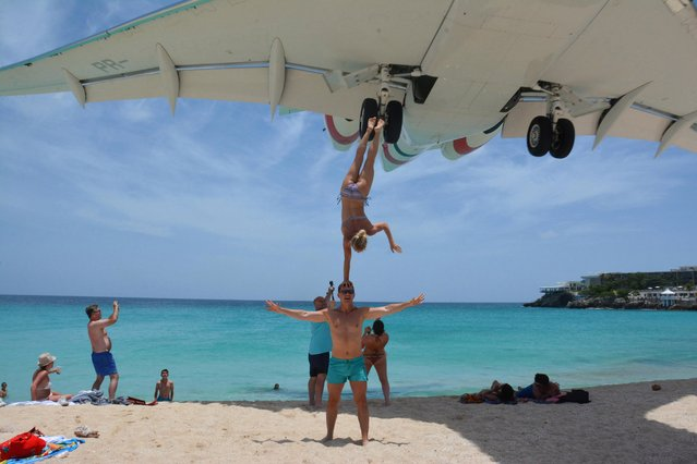 "A commercial airline landing at the Princess Juliana International Airport in St Maarten on July 9, 2018. Ukrainians Oleg Kolisnichenko, 36, and Yulia Nos, 25, have been blasted for the ""stupid stunt"" on Maho Beach, which lies next to the main airport on the Caribbean island of Saint Martin. The stunt was met with criticism rather than praise from social media users. (Photo by SWNS: South West News Service)"