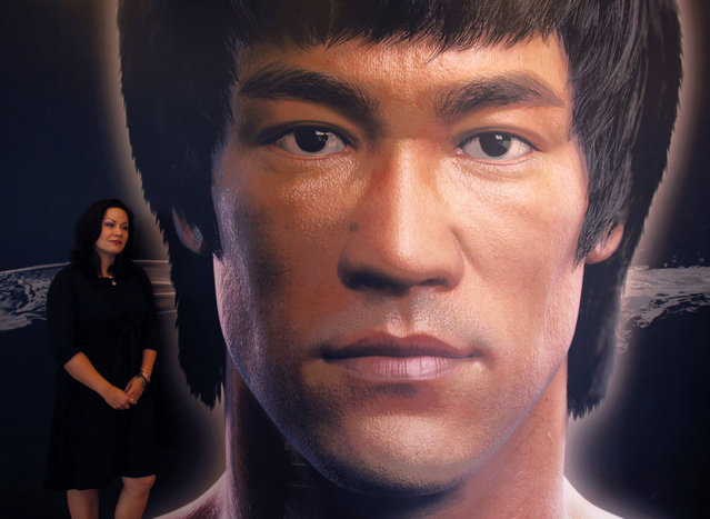 Shannon Lee, daughter of the late Kung Fu legend Bruce Lee, poses beside a portrait of her father at the Hong Kong Heritage Museum, before the start of a five-year exhibition on Lee, July 18, 2013. Late kung fu superstar Bruce Lee may be an international icon, but he is still not the complete local hero in Hong Kong. Fans are marking his death 40 years ago this weekend with art gallery shows, exhibitions and even street graffiti but some people are urging Hong Kong's government to do more to honour the former British colony's biggest star. (Photo by Bobby Yip/Reuters)