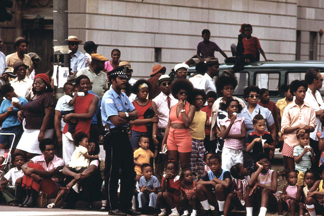 Members of Chicago's South Side community line a portion of Dr. Martin L. King Jr. Drive to watch the Bud Billiken Day Parade, August 1973. Hundreds of thousands turn out to watch and take part in the annual event. Bud Billiken Day started in 1929, to provide African-American youth living on the South Side a moment in the spotlight, a day each year to showcase their talents. (Photo by John H. White/NARA via The Atlantic)