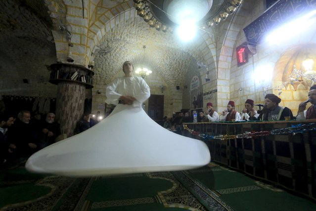 A whirling dervish performs a traditional Sufi dance on the occasion of Prophet Mohammed's birthday in Aleppo, Syria December 25, 2015. (Photo by Ammar Abdullah/Reuters)