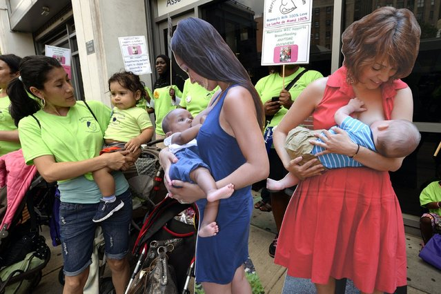 "Women stand next to cardboard posters in the Washington Heights section of New Yorkas they participate in the annual ""Breastfeeding Subway Caravan"" to mark ""World Breastfeeding Week"", on August 3, 2013. (Photo by AFP Photos/Getty Images)"